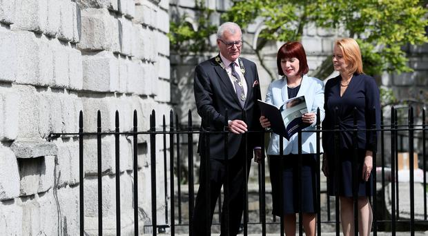 Culture minister Josepha Madigan (centre) with President of The Law Society Patrick Dorgan (left) and Deputy Director General Mary Keane (Brian Lawless/PA)
