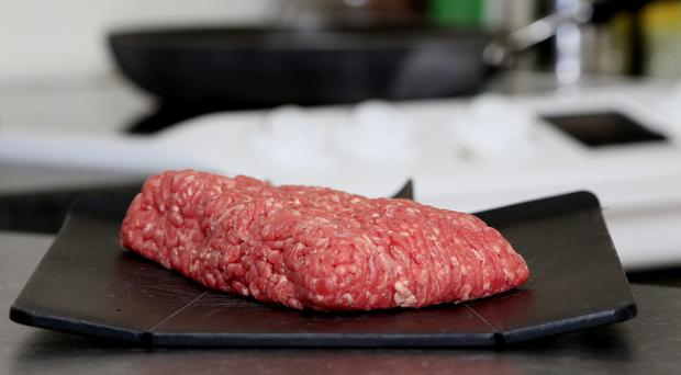 An environmental expert has said eating less beef will help to reduce people's carbon footprints (Jonathan Brady/PA)
