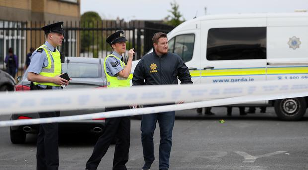 Police at the scene in the Marigold Road area of Darndale, as a second man has been shot dead in Dublin in less than 24 hours (Brian Lawless/PA)