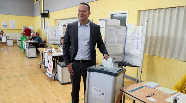 Taoiseach Leo Varadkar casts his vote at Scoil Thomais, Castleknock, Dublin (Brian Lawless/PA)