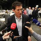 Green Party Leader Eamon Ryan speaks to the media as ballot boxes are opened and counting begins in Dublin (PA)