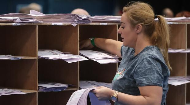 Ballot boxes are opened and counting begins in the Local and European Elections and divorce referendum at the RDS in Dublin (PA)