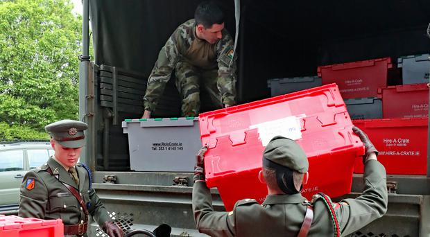 Members of the defence forces load ballots on to trucks in Ireland (Niall Carson/PA)