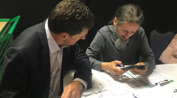Luke Flanagan discusses the numbers with Green Party leader Eamon Ryan (Aoife Moore/PA)
