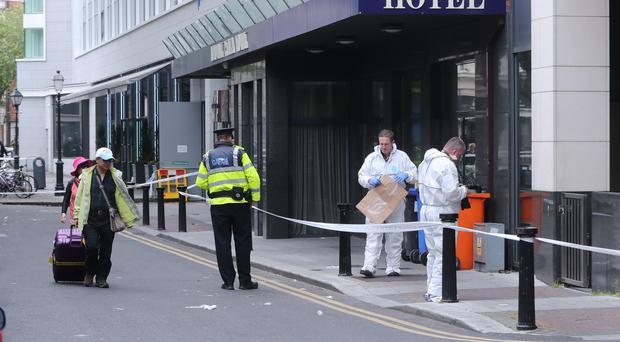 Gardai at the scene near O'Connell Street in Dublin (Niall Carson/PA)