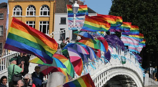 Dublin Pride flags and umbrellas on Ha'Penny Bridge, Dublin (Niall Carson/PA)