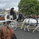The coffin of Philomena Lynott arrives at the church (Niall Carson/PA)
