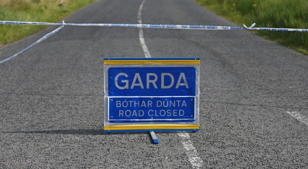 The road was closed after the incident in the early hours of Monday (Niall Carson/PA)