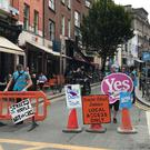 Demonstrators erected temporary traffic measures in Dublin's South William Street (Michelle Devane/PA)