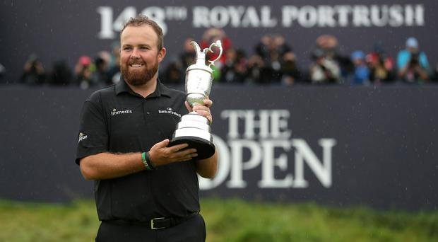 Shane Lowry celebrates with the Claret Jug after winning The Open Championship 2019 at Royal Portrush Golf Club (David Davies/PA)