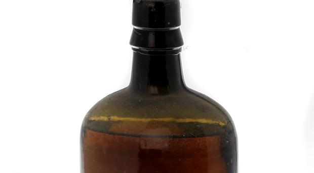 1880s bottle of Cassidy and Co whiskey (Eugene T. Hamill Photography/PA)