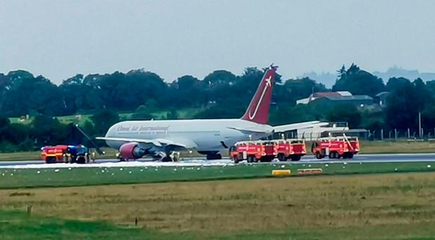 Firecrews attending an aircraft on the tarmac at Shannon Airport