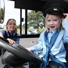 "Driver Suzanne Armstrong and Naoise O'Molloy, five, from Trim, at the Launch of Dublin Buses ""Give it a Spin"" recruitment drive for female bus drivers at Pheonix Park in Dublin today."