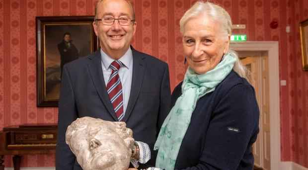 The Countess of Dunraven presenting the death mask of Daniel O'Connell to Maurice Buckley, Chairman of the OPW at a special ceremony during the annual Daniel O'Connell Summer school in Derrynane House, Co Kerry (John Allen/PA)