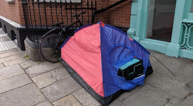 Photo issued by Councillor Lawrence Hemmings of a Deliveroo driver living in a tent in Dublin city centre (Lawrence Hemmings/PA)