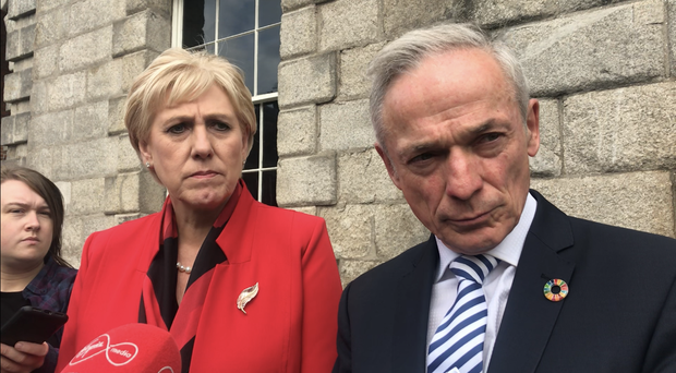Heather Humphreys and Richard Bruton speaking outside Dublin Castle (Cate McCurry./PA)