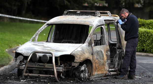 A burnt out car was seen nearby in Lucan, Co Dublin after a man was shot (Brian Lawless/PA)