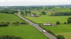 A picture taken with a drone of a Border crossing between Co Fermanagh in Northern Ireland and Co Monaghan in the Republic of Ireland near the town of Clones (Niall Carson/PA)