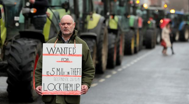 Finbar Reburn, a farmer from Cavan, alongside tractors parked on the streets around St Stephen's Green (Brian Lawless/PA)