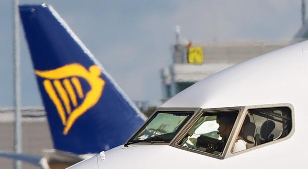 Ryanair is to close two bases following aircraft delivery delays (Niall Carson/PA)