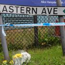Flowers near the scene in Grays after 39 bodies were found inside a lorry (Aaron Chown/PA)