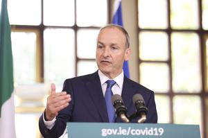 Taoiseach Micheal Martin speaking in Dublin at the unveiling of the Irish government's blueprint for living with Covid-19 (Julien Behal/PA)