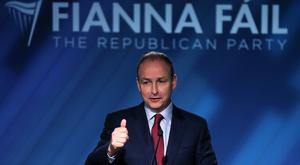 Fianna Fail leader Micheal Martin speaking at the party's opening press conference of the general election at their election headquarters in Dublin city centre (Brian Lawless/PA)