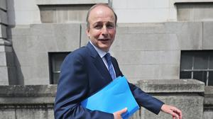 Fianna Fail leader Micheal Martin who is set to become Ireland's next premier, outside Government Buildings in Dublin (Niall Carson/PA)