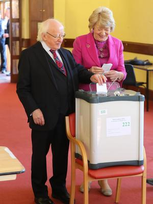 President Michael D Higgins and his wife Sabina cast their votes at the polling station in St Mary's Hospital, Phoenix Park, Dublin (Niall Carson/PA)