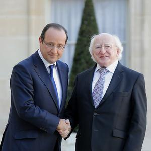 French president Francois Hollande shakes hands with President Michael Higgins at the Elysee Palace in Paris (AP)