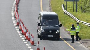 Gardai mount coronavirus checkpoints at junction 7 on the M1 motorway near Bettystown in Co Meath (PA)