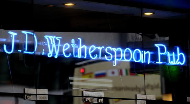 Wetherspoons is to invest more than £200m in pubs and hotels over the next four years, creating around 10,000 jobs (Tim Ireland/PA)