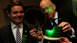Tourism minister Paschal Donohoe, left, and Foreign Affairs minister Charlie Flanagan recreate how some global landmarks will look on St Patrick's Day