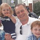 Andrew McGinley with his three children (Family handout/PA)