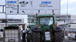 Tractors make their way past Dublin Port (Brian Lawless/PA)