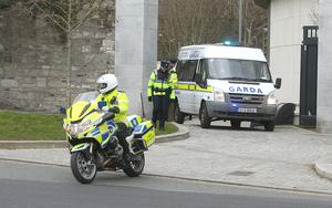 A Garda van takes him from court after sentencing