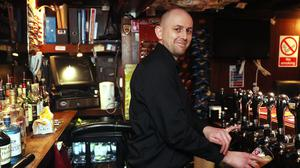 Stephen Reynolds, bar manager at the Dawson Lounge in Dublin's city centre, as the D�il has passed legislation to allow pubs to serve alcohol on Good Friday. (Brian Lawless/PA)