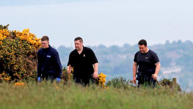 Gardai in the Puck's Castle area near Dublin during the search for Jastine Valdez