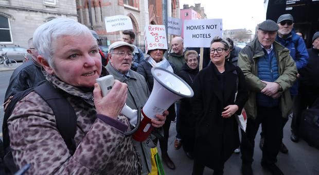 People Before Profit TD Brid Smith (left) addresses a demonstration at the site of a proposed new high rise hotel on Vicar Street in Dublin.