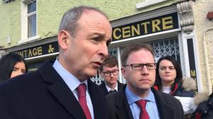 Fianna Fail leader Micheal Martin campaigning with James Lawless (Aine McMahon/PA)