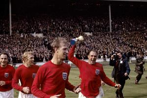 England's George Cohen, Bobby Moore, Jack Charlton and Ray Wilson, with trophy, celebrate after winning the World Cup in 1966 (PA Archive)