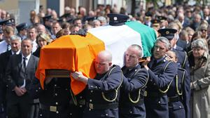 The coffin of Detective Garda Colm Horkan is carried to St James' church in Charlestown, Co Mayo (Brian Lawless/PA)