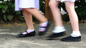 A distance of one metre should be maintained between pupils when schools reopen (Ian West/PA).