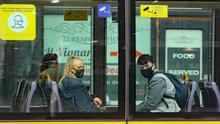 People wearing face coverings on a Luas Tram in Dublin (Niall Carson/PA)