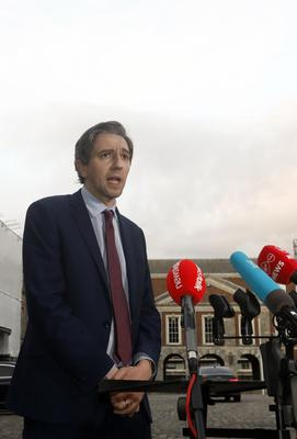 Health Minister Simon Harris said the clear public health advice was that they should be worn on public transport and in enclosed indoor spaces like shops (Leon Farrell/Photocall Ireland/PA)