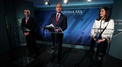 Fianna Fail leader Micheal Martin (centre), Deputy leader Dara Calleary (left) and candidate for Dublin South Central Catherine Ardagh (Brian Lawless/PA)