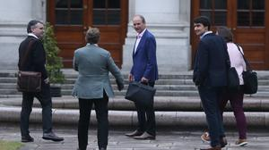 Fianna Fail leader Micheal Martin (centre) arrives at Government Buildings in Dublin (PA)