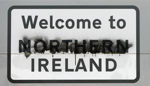 A defaced road sign on the border between Donegal and Derry (Niall Carson/PA)