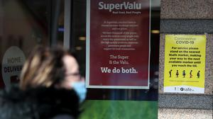 Posters with guidelines on social distancing at a store in Dublin (Brian Lawless/PA)