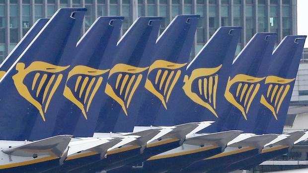Ryanair is planning to restore 40% of its flight schedule from July but Health Secretary Matt Hancock has warned people are unlikely to be able to go on foreign holiday this summer (Niall Carson/PA)